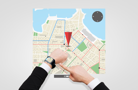 business, people and modern technology concept - close up of businessman pointing to smart watch at his hand with gps navigator map on screen Stock Photo