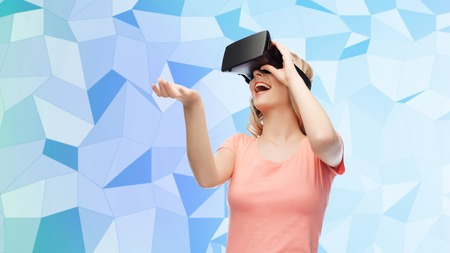 entertainment background: technology, virtual reality, entertainment and people concept - happy young woman with virtual reality headset or 3d glasses over blue low poly texture background