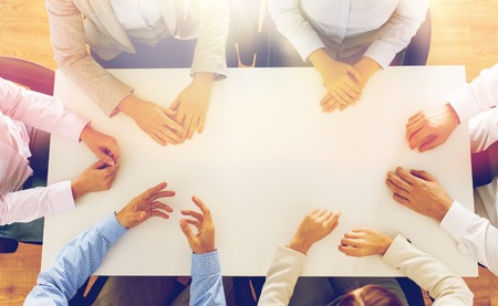business team: business, people and team work concept - close up of creative team sitting at table in office