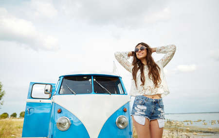 minivan: summer holidays, road trip, vacation, travel and people concept - smiling young hippie women in minivan car Stock Photo