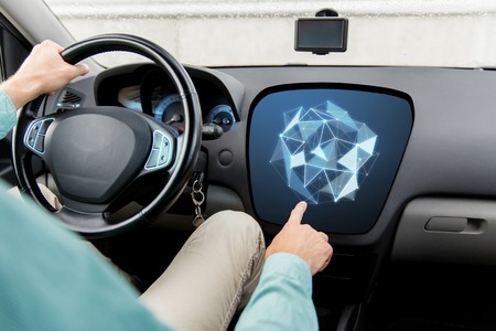 finger shape: transport, modern technology and people concept - close up of man driving car and pointing finger to low poly shape on board computer screen