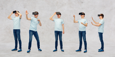 entertainment background: 3d technology, virtual reality, entertainment, cyberspace and people concept - young man with virtual reality headset or 3d glasses set over gray concrete room background