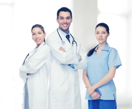 physicians: healthcare, hospital and medical concept - young team or group of doctors