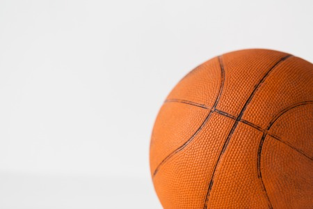objects equipment: sport, fitness, game, sports equipment and objects concept - close up of basketball ball Stock Photo