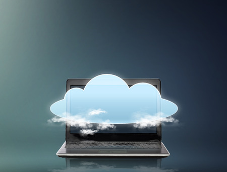 telecommunications: technology, computing and telecommunication concept - laptop computer with cloud projection over gray background