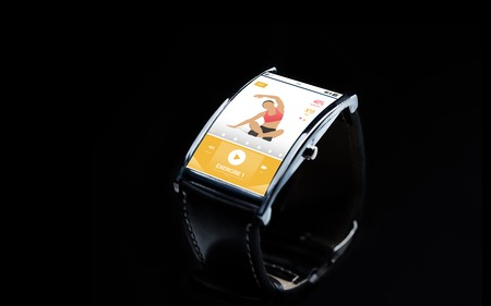sport object: modern technology, sport, object and media concept - close up of black smart watch with fitness app on screen