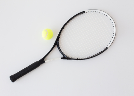 objects equipment: sport, fitness, sports equipment and objects concept - close up of tennis racket with ball Stock Photo