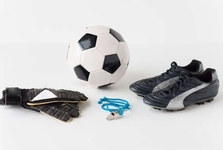 soccer boots: sport, soccer and sports equipment concept - close up of ball, whistle, goalkeeper gloves and football boots Stock Photo