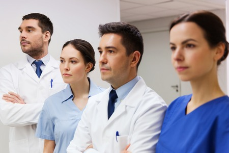 health care and medicine: clinic, profession, people, health care and medicine concept - group of medics or doctors at hospital corridor Stock Photo