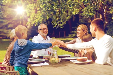 three generations of women: family, happiness, generation, home and people concept - happy family having holiday dinner outdoors