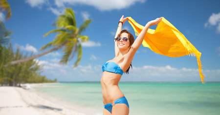 sun beach: people, summer holidays and vacation concept - beautiful woman in bikini and sunglasses with pareo over exotic tropical beach with palm trees background Stock Photo