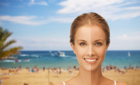 visage: people, suntan, travel and summer holidays concept - close up of beautiful smiling woman with half face tanned over resort beach background Stock Photo