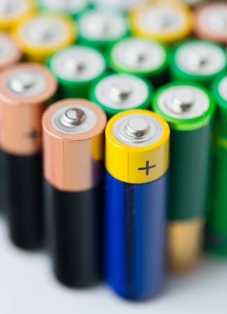 utilization: recycling, energy, power, environment and ecology concept - close up of alkaline batteries heap