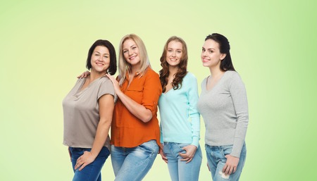 green clothes: friendship, fashion, body positive, diverse and people concept - group of happy different size women in casual clothes over green natural background