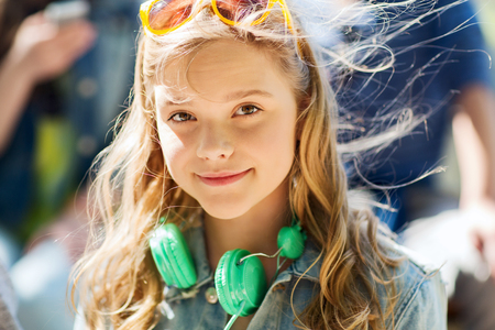 carelessness: people, summer and portrait concept - happy teenage girl with headphones