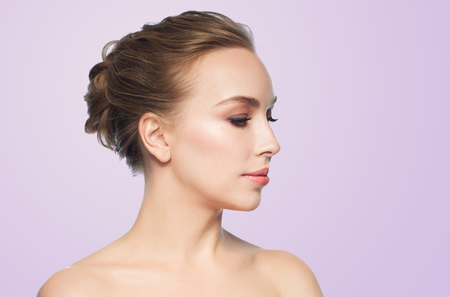noses: health, people, plastic surgery and beauty concept - beautiful young woman face over violet background