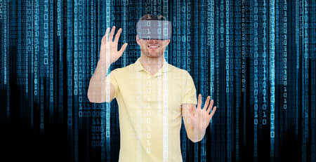 entertainment concept: 3d technology, virtual reality, entertainment and people concept - happy young man with virtual reality headset or 3d glasses playing game Stock Photo