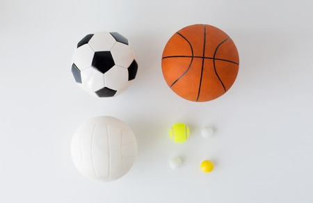 objects equipment: sport, fitness, game, sports equipment and objects concept - close up of different sports balls set over white background from top Stock Photo