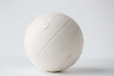 objects equipment: sport, fitness, game, sports equipment and objects concept - close up of volleyball ball