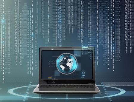 tecnología informatica: tecnología y red concepto - ordenador portátil con el planeta tierra en la pantalla y código binario sobre fondo gris