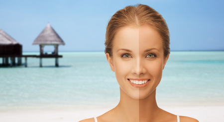 visage: people, suntan, travel and summer holidays concept - close up of beautiful smiling woman with half face tanned over exotic tropical beach with bungalow background
