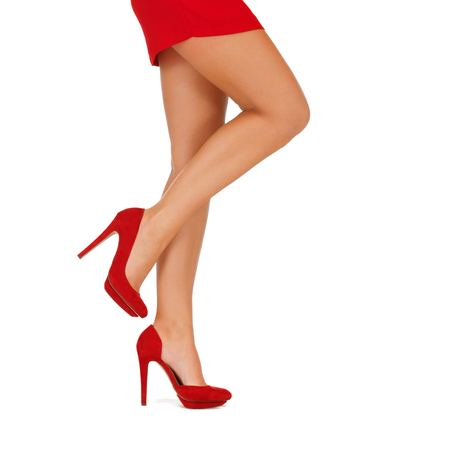 mini dress: people, fashion and footwear concept - close up of woman legs in red high heeled shoes