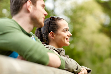 bridge in nature: travel, hiking, backpacking, tourism and people concept - smiling couple with backpacks on bridge in nature Stock Photo