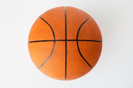 objects equipment: sport, fitness, game, sports equipment and objects concept -close up of basketball ball over white background