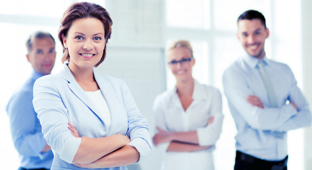 picture of smiling attractive businesswoman in office Stock Photo