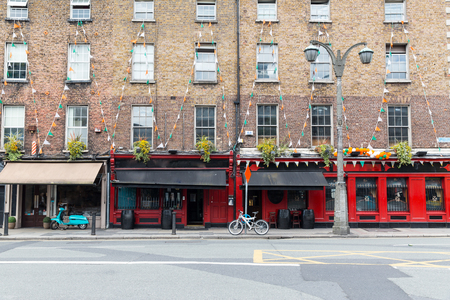 decorated bike: architecture concept - building with bar or pub on street of Dublin city Stock Photo
