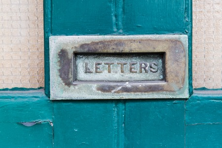 post mail: communication, correspondence, mail and post service concept- close up of vintage mailbox