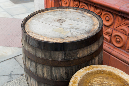 old furniture: furniture and object concept - close up of old wooden barrel table at bar or pub outdoors Stock Photo