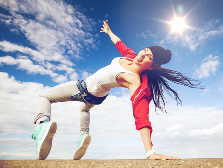 urban culture: sport, dancing and urban culture concept - beautiful dancing girl in movement