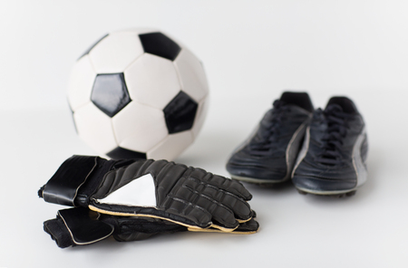 soccer boots: sport, soccer, football and sports equipment concept - close up of ball, boots and goalkeeper gloves