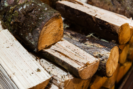 stove heating, fuel and wood concept - close up of firewood pile Stock Photo