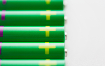 green power: recycling, energy, power, environment and ecology concept - close up of green alkaline batteries Stock Photo