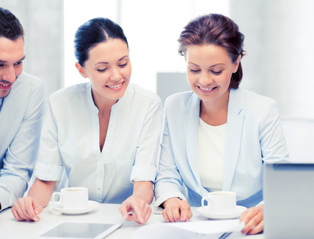 common goal: friendly business team having discussion in office