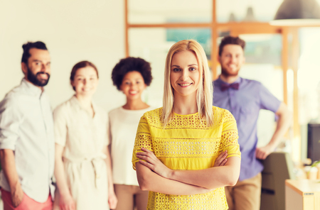 young businessman: business, startup, people and teamwork concept - happy young woman over creative team in office Stock Photo