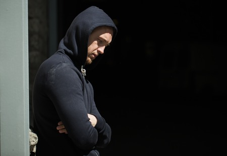 youth crime: substance abuse, addiction, people and social problem concept - close up of addict man on street Stock Photo