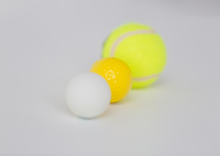 objects equipment: sport, fitness, game, sports equipment and objects concept - close up of different sports balls set Stock Photo