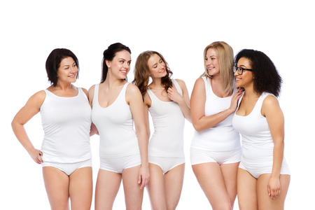 beauty body: friendship, beauty, body positive and people concept - group of happy women different in white underwear
