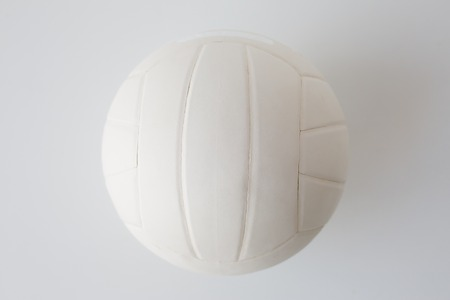 objects equipment: sport, fitness, game, sports equipment and objects concept - close up of volleyball ball on white
