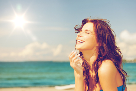releaxed: bright picture of laughing woman on the beach.