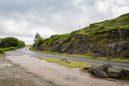 travel and countryside concept - asphalt road at connemara in ireland