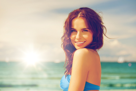 releaxed: bright picture of happy smiling woman on the beach. Stock Photo