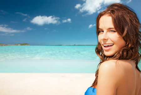 vacation summer: travel, tourism, summer vacation and people concept - happy beautiful woman over tropical beach background