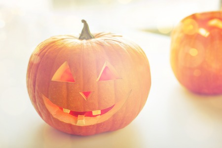celebration smiley: holidays, halloween and decoration concept - close up of pumpkins on table Stock Photo