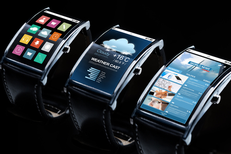 news cast: modern technology, object and media concept - close up of black smart watch set with weather cast, business news and menu icons Stock Photo