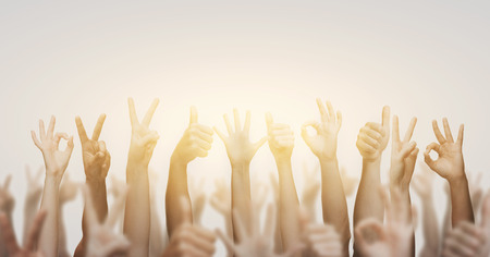 many people: gesture and body parts concept - human hands showing thumbs up, ok and peace signs