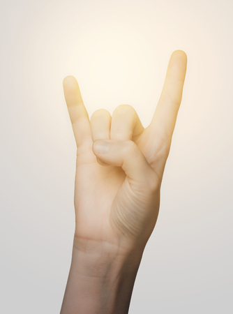 body parts: gesture and body parts concept - close up of woman hand showing rock hand sign Stock Photo